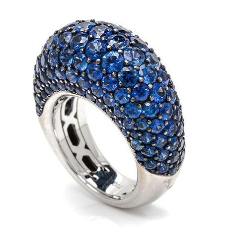 An 18 Karat White Gold and Sapphire Ring, 16.90 dwts.