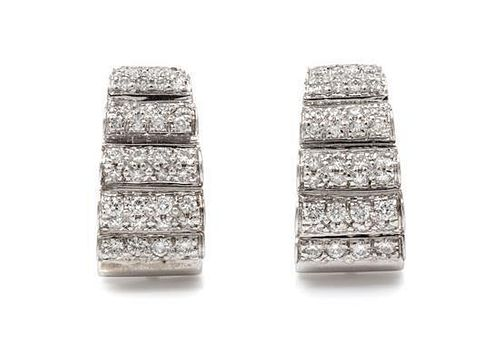 * A Pair of 14 Karat White Gold and Diamond Earclips, 9.00 dwts.