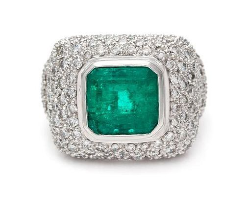A White Gold, Emerald and Diamond Ring, 10.30 dwts.