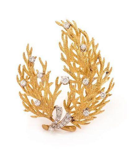 An 18 Karat Bicolor Gold and Diamond Brooch, 16.10 dwts.