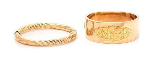 * A Collection of 14 Karat Yellow Gold Bangle Bracelets, 41.60 dwts.