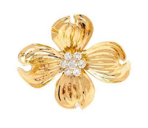 An 18 Karat Yellow Gold and Diamond Dogwood Flower Brooch, 8.50 dwts.