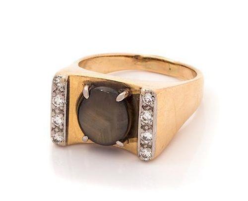 A 14 Karat Yellow Gold, Black Star Sapphire and Diamond Ring, 5.50 dwts.