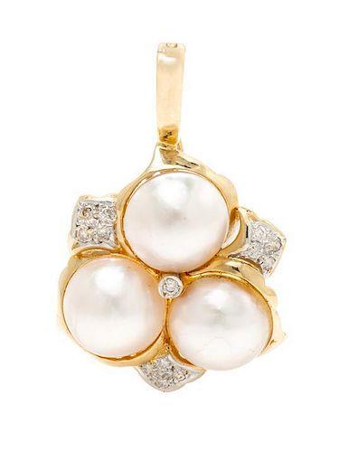 * A 14 Karat Yellow Gold, Mabe Pearl and Diamond Pendant, 4.80 dwts.