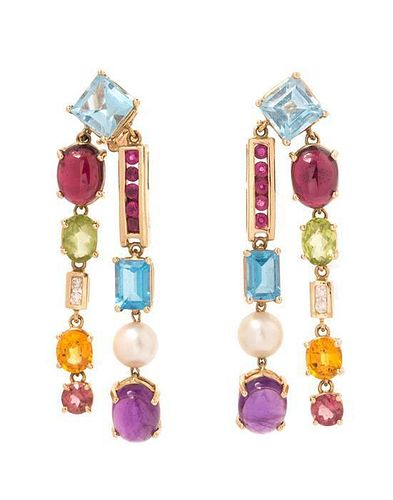 A Pair of Yellow Gold and Multigem Earclips, 10.80 dwts.