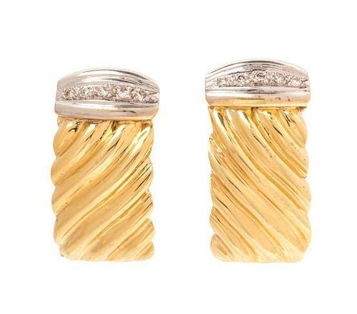 A Pair of Bicolor Gold and Diamond Earclips, 11.90 dwts.