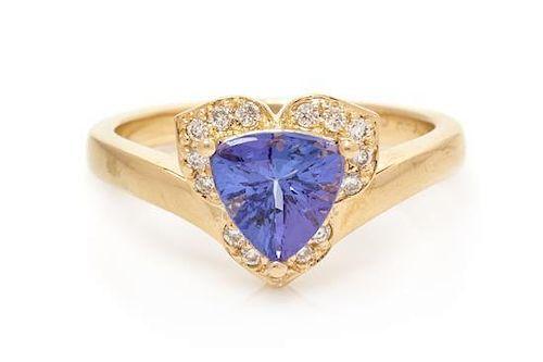 A 14 Karat Yellow Gold, Tanzinite and Diamond Ring, 2.80 dwts.