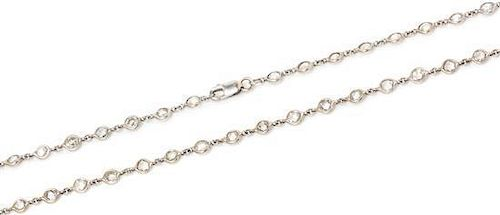 An 18 Karat White Gold and Diamond Station Necklace, 6.00 dwts.