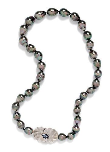 * A White Gold, Sapphire and Graduated Cultured Tahitian Pearl Necklace, 60.00 dwts.