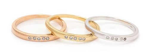 A Collection of 14 Karat Gold and Diamond Stacking Rings, 3.60 dwts.