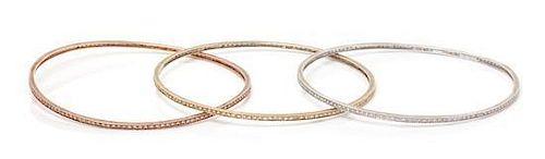 A Collection of 14 Karat Gold and Diamond Bangle Bracelets, 14.20 dwts.