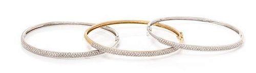 A Collection of 14 Karat Gold and Diamond Bangle Bracelets, 19.30 dwts.