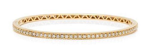 An 18 Karat Yellow Gold and Diamond Bangle Bracelet, 7.60 dwts.