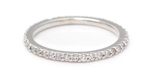 An 18 Karat White Gold and Diamond Eternity Band, 1.80 dwts.