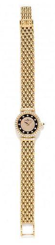 * An 18 Karat Yellow Gold and Diamond Wristwatch, Baume & Mercier, 23.90 dwts.