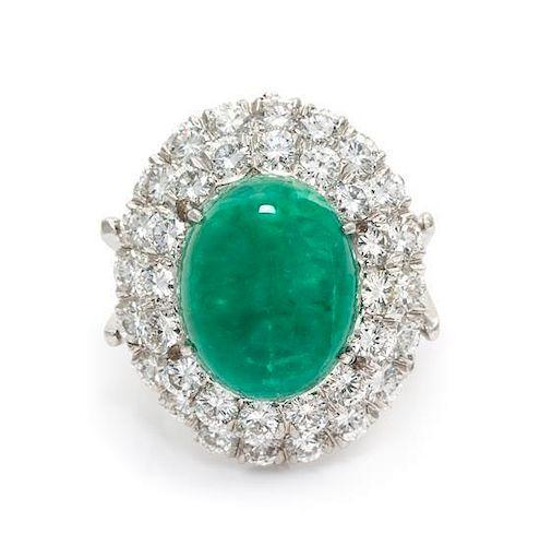 An 18 Karat White Gold, Emerald and Diamond Ring, 6.90 dwts.