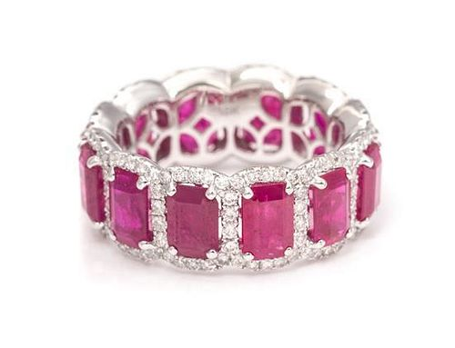 An 18 Karat White Gold, Ruby and Diamond Eternity Band, 4.90 dwts.