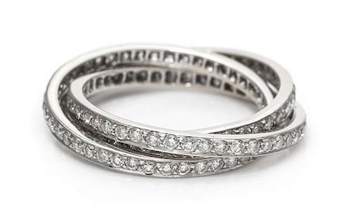 A White Gold and Diamond Triple Rolling Ring, 4.40 dwts.