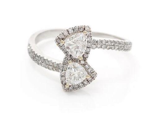 * A 14 Karat White Gold and Diamond Toi et Moi Ring, 1.90 dwts.