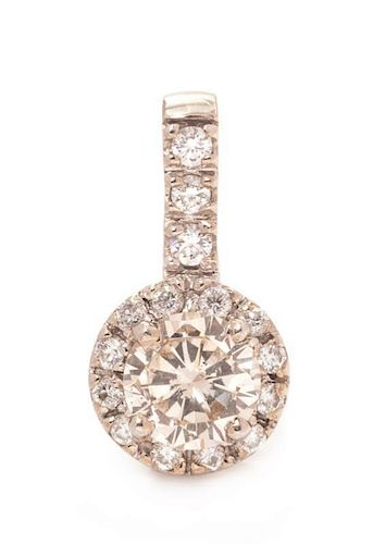* A White Gold and Diamond Pendant, 1.15 dwts.