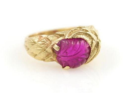 An 18 Karat Yellow Gold and Carved Ruby Ring, Circa 1945, 5.10 dwts.