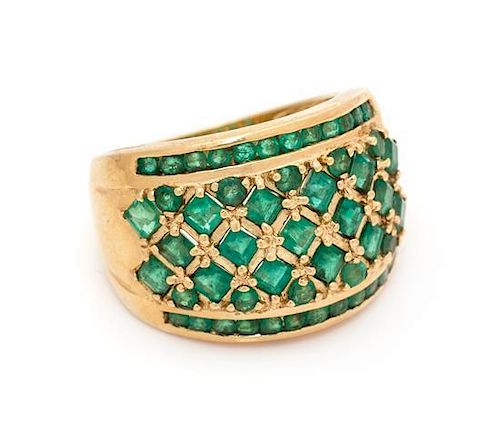 A 14 Karat Yellow Gold and Emerald Ring, 8.40 dwts.