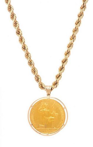 * A Yellow Gold and Panama 500th Anniversary Birth of Balboa Commemorative Coin Pendant and Chain Necklace, 55.10 dwts.