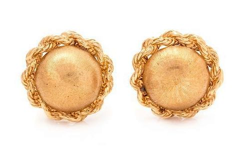 A Pair of 14 Karat Yellow Gold Earclips,