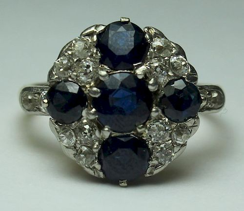 JEWELRY. Sapphire and Diamond Cluster Ring.