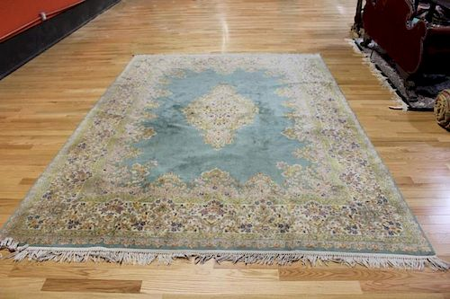 Antique and Finely Woven Kirman Carpet.