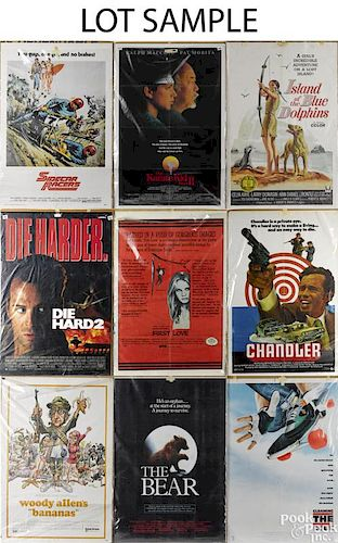Large collection of movie posters, mostly 1980's