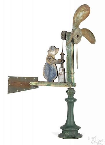 Painted whirligig of a woman with a churn