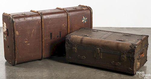 Two antique steamer trunks.