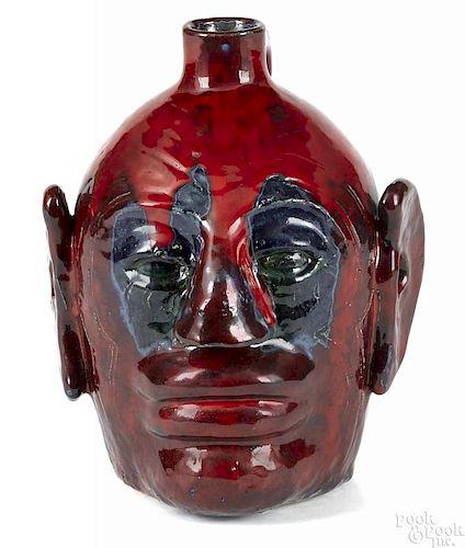 Edwin Meaders red glaze stoneware face jug