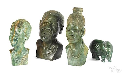 Three African carved stone busts