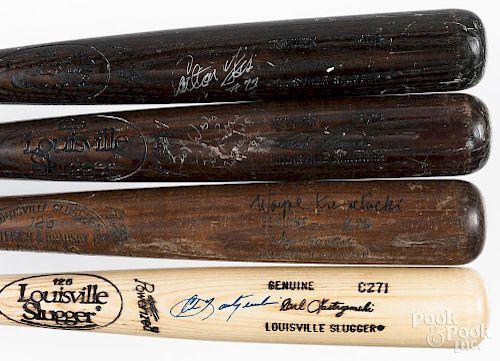 Four autographed baseball bats