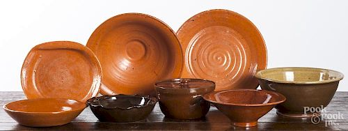 Eight Jugtown pottery serving dishes.