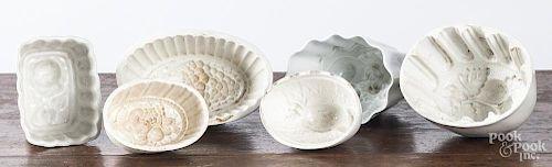 Six white ironstone food molds.