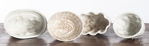 Four white Ironstone food molds.