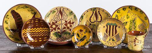 Eight Breininger redware plates
