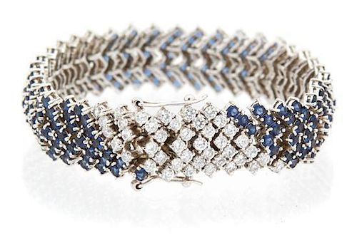 A Sterling Silver Faux Sapphire and Cubic Zirconia Line Bracelet Length 7 inches.