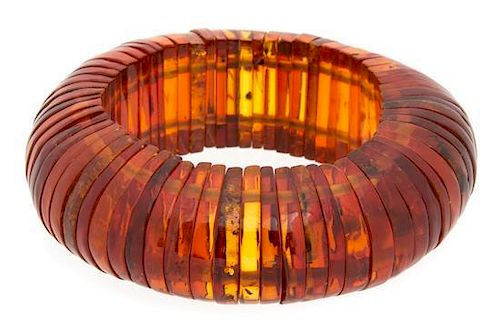 A Group of Faux Amber Diameter of bracelet 3 1/4 inches.