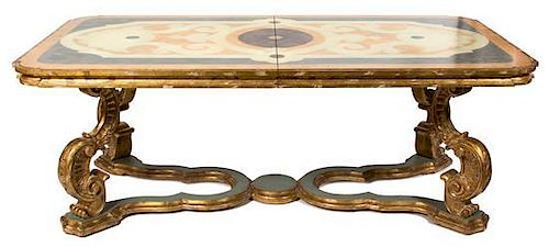 An Italian Rococo Style Dining Table Height 31 x width 84 x depth 46 inches (without leaves).