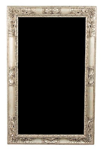 An Italian Carved Silver Gilt Framed Mirror Height 58 3/4 x width 34 inches