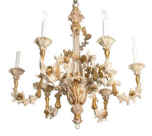 A Louis XV Style Carved Parcel Gilt Six-Light Chandelier Height 27 x diameter 27 inches.