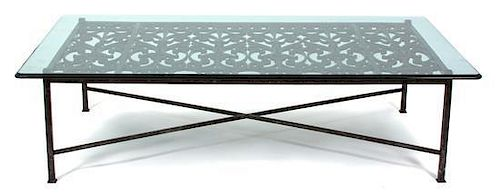 A French Wrought Iron Coffee Table Height 18 1/4 x width 64 x depth 36 1/2 inches.