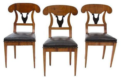 Three Beidemeier Walnut and Ebonized Side Chairs Height 36 inches.