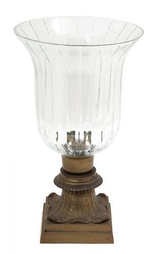 A Regency Style Cut Crystal and Bronze Hurricane Lamp Height 13 inches.