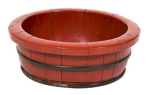 A Chinese Red Lacquered Metal Bound Bowl Height 7 1/4 x diameter 20 1/4 inches.