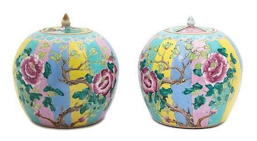 A Pair of Chinese Famille Rose Porcelain Covered Jars Height 9 x diameter 8 1/4 inches.